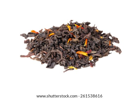 Small pile of big leaf black tea mixed with safflower and hibiscus petals isolated on white background, selective focus with shallow DOF - stock photo