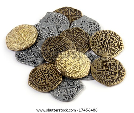Small pile of Doubloons and Reales. - stock photo