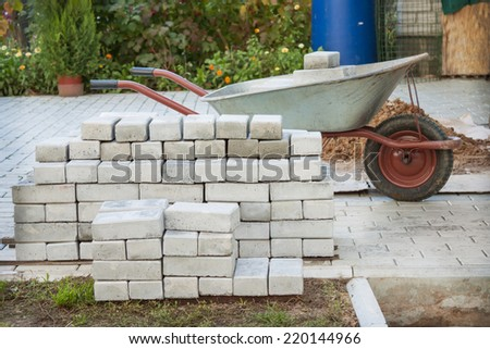 Small pile of paving stones on a construction site - stock photo