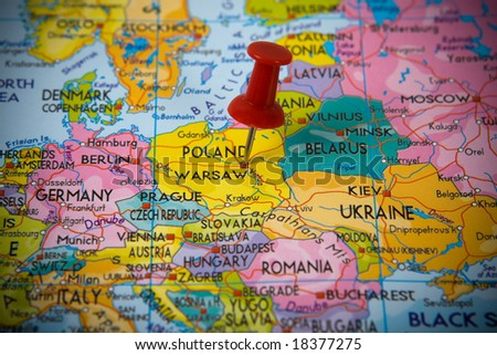Small pin pointing on Warsaw (Poland)  in a map of Europe - stock photo