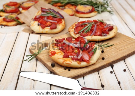 Small pizzas on baking paper close up