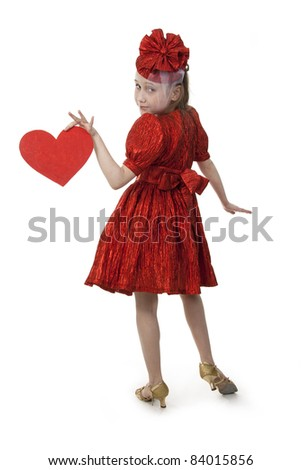 Small playful girl standing with heart in her hands, symbolizing love - stock photo