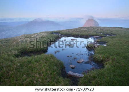 Small pond near the summit of Suilven Mountain, northern Scotland. - stock photo