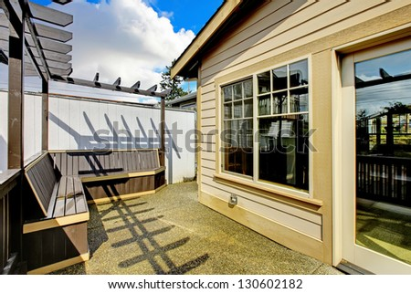 Small porch with benches in the back of the house. new luxury home exterior.