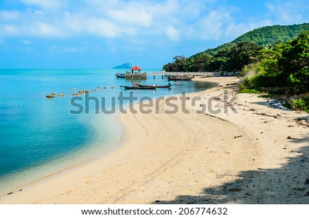 Small port on the beach with long-tailed boat at fishing village, small island, Thailand - stock photo