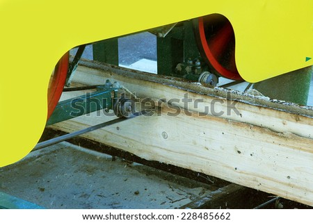 Small portable band saw sawmill being used to cut a wooden boards - stock photo