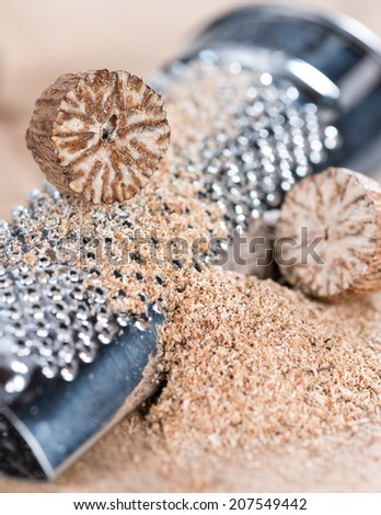 Small portion of fresh grated Nutmegs (close-up shot) - stock photo