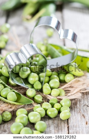Small portion of fresh harvested Peas (close-up shot) - stock photo