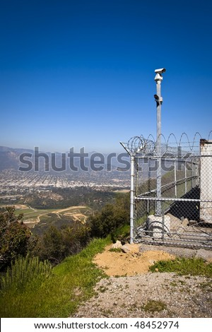 Small Power Station Overlooking Town - stock photo