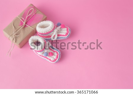 Small present in recicled craft paper on pink background - stock photo
