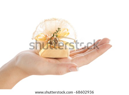 Small present in woman's hand. Isolated on white - stock photo