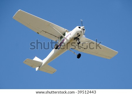 Small private airplane passing overhead - stock photo