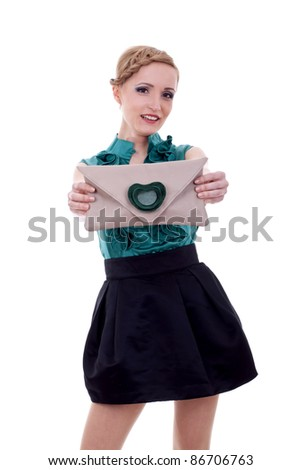 small purse is being presented by an attractive young woman - stock photo