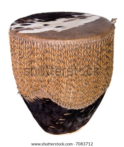 Small rawhide Indian drum shot over white. - stock photo