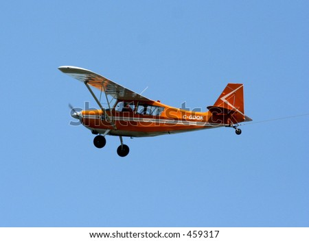Small red airplane - stock photo