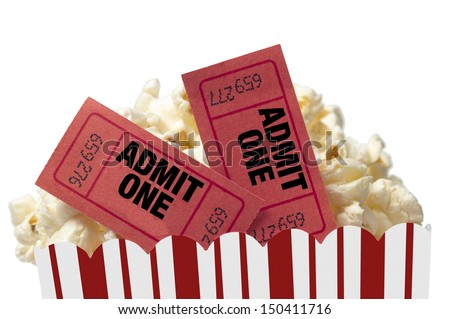 Small Red and White Bucket Of Popcorn With Two Red Movie Tickets/ Movie Night Close Up On White - stock photo