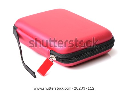Small red bag with zipper on white background - stock photo