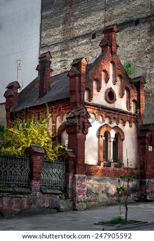 Small red brick house close to the center of Lviv, probably medieval - stock photo