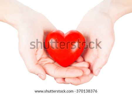 small red heart in hands. health concept