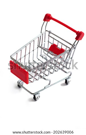 Small red shopping cart isolated over the white background - stock photo