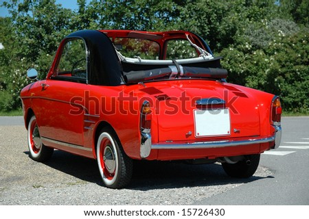 Small red sports car - stock photo