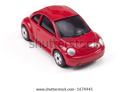 small red toy beetle car - stock photo