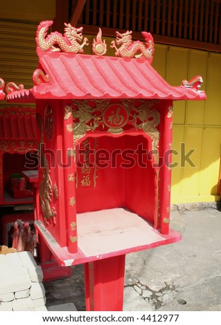 Small red traditional chinese family shrine with dragon motif