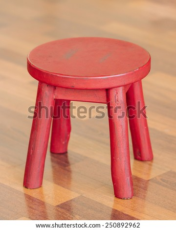 Small Red Wooden Stool - stock photo