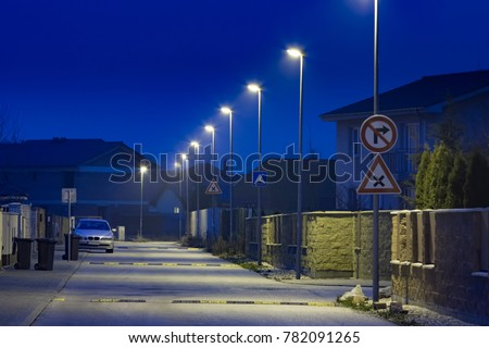 Small Residential Street With Modern LED Street Lights At Night