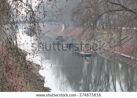 Small river, Esztergom, Hungary on winter hazy day