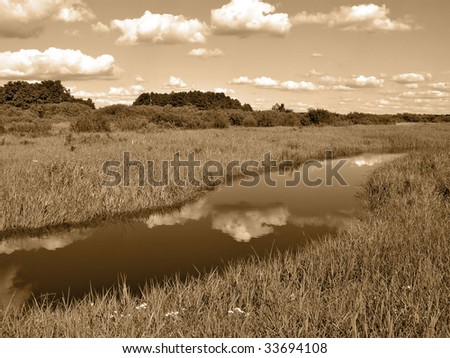 small river on field - stock photo