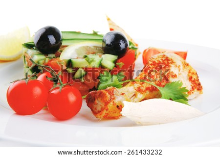 small roast meat chunks on white plate - stock photo