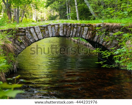 Small rock bridge over forest channel, Vchynice-Tetov Transport Channel, Bohemian Forest, Czech Republic