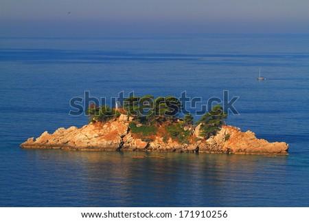 Small rocky island on the Adriatic sea - stock photo
