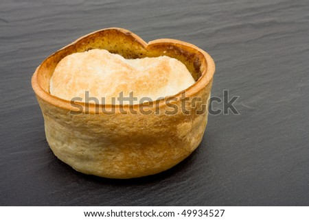 Small round scottish style Steak and Gravy Pie isolated against white background. - stock photo