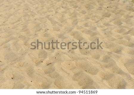 Small sand dunes on  beach. Sand texture - stock photo