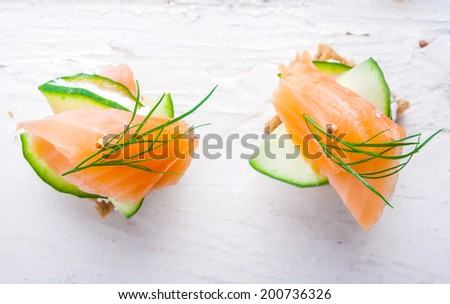 small sandwiches with salmon and cream cheese