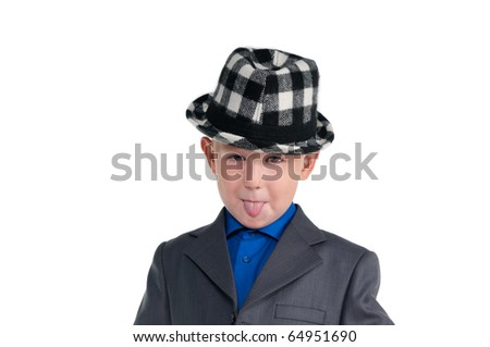 Small schoolboy with suit and hat making faces