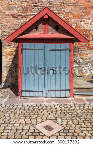Small shed or outhouse from 1973 inside Akershus fortress in Oslo, Norway. - stock photo