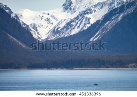 Small Ship within Great Alaskan Wilderness. - stock photo