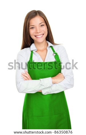 Small shop owner, entrepreneur or sales clerk standing happy and proud wearing apron. Young woman isolated on white background. - stock photo