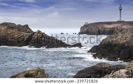 Small sign house, and a modern military  tower coastline on a big island in the atlantic ocean, france. - stock photo