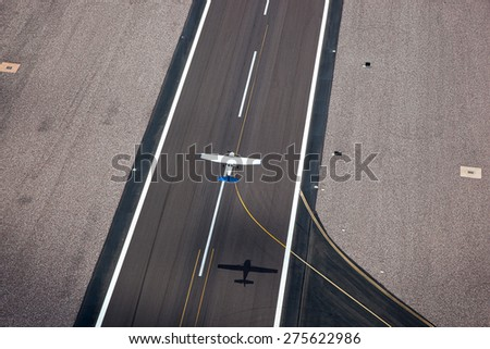 Small single engine plane taking off as viewed from above - stock photo