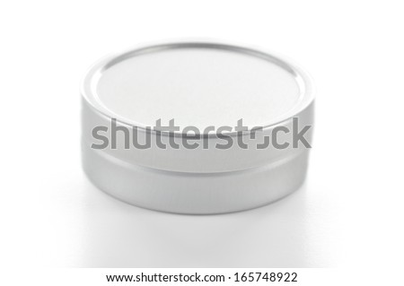 Small size metallic tin made with brushed aluminium on white background. - stock photo
