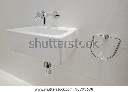 small size modern square shape hand wash basin in a rest room - stock photo