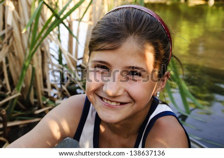small smiling girl - stock photo