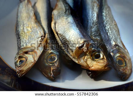 small smoked fish, horse mackerel, on a plate