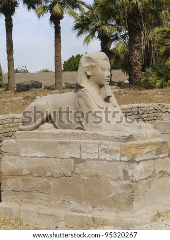 Small sphinx outside the entrance to Luxor Temple in Egypt