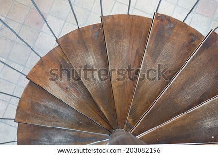 Small spiral stairs with wooden steps - stock photo