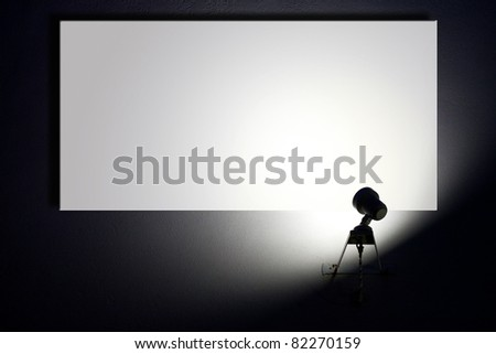 Small spotlight lighting blank white advertisement board on the wall - stock photo